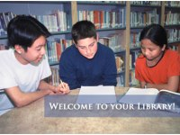 Children sitting at a library table